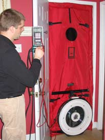 Air leakage being tested with a Blower Door